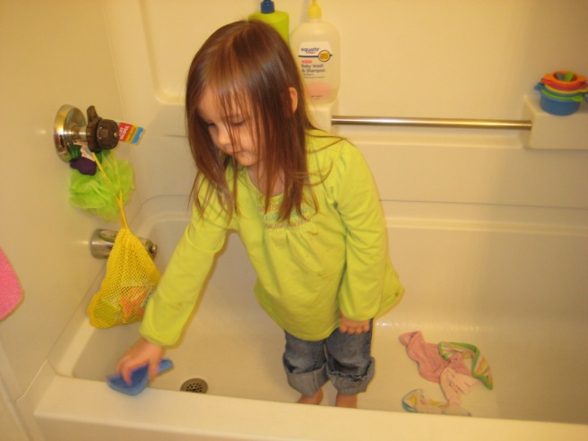 """In her element, """"playing"""" with water"""
