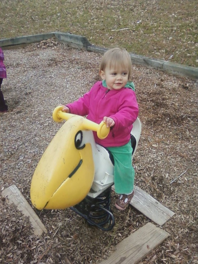 Mckayla also enjoyed the slides, swings, a rocking pelican, and tromping around in the leaves.