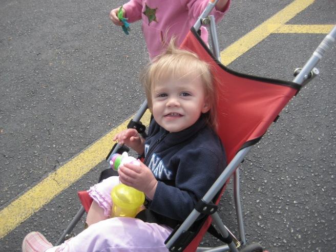Mckayla, who happily rode in the stroller. She did get to share in the treats the girls won.