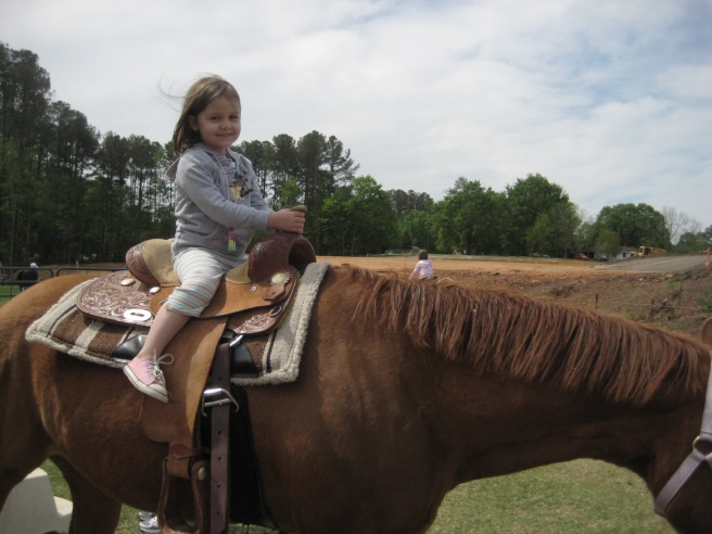 Can anything make a little girl smile like that except a horse?
