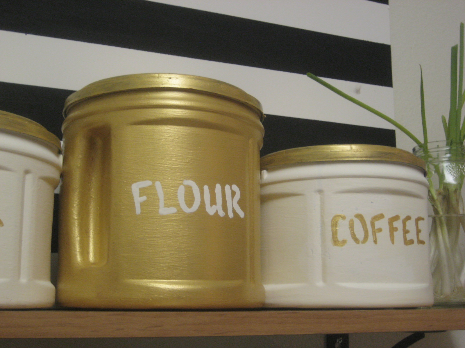 Diy gilded canisters made from plastic folgers coffee for Coffee crafts
