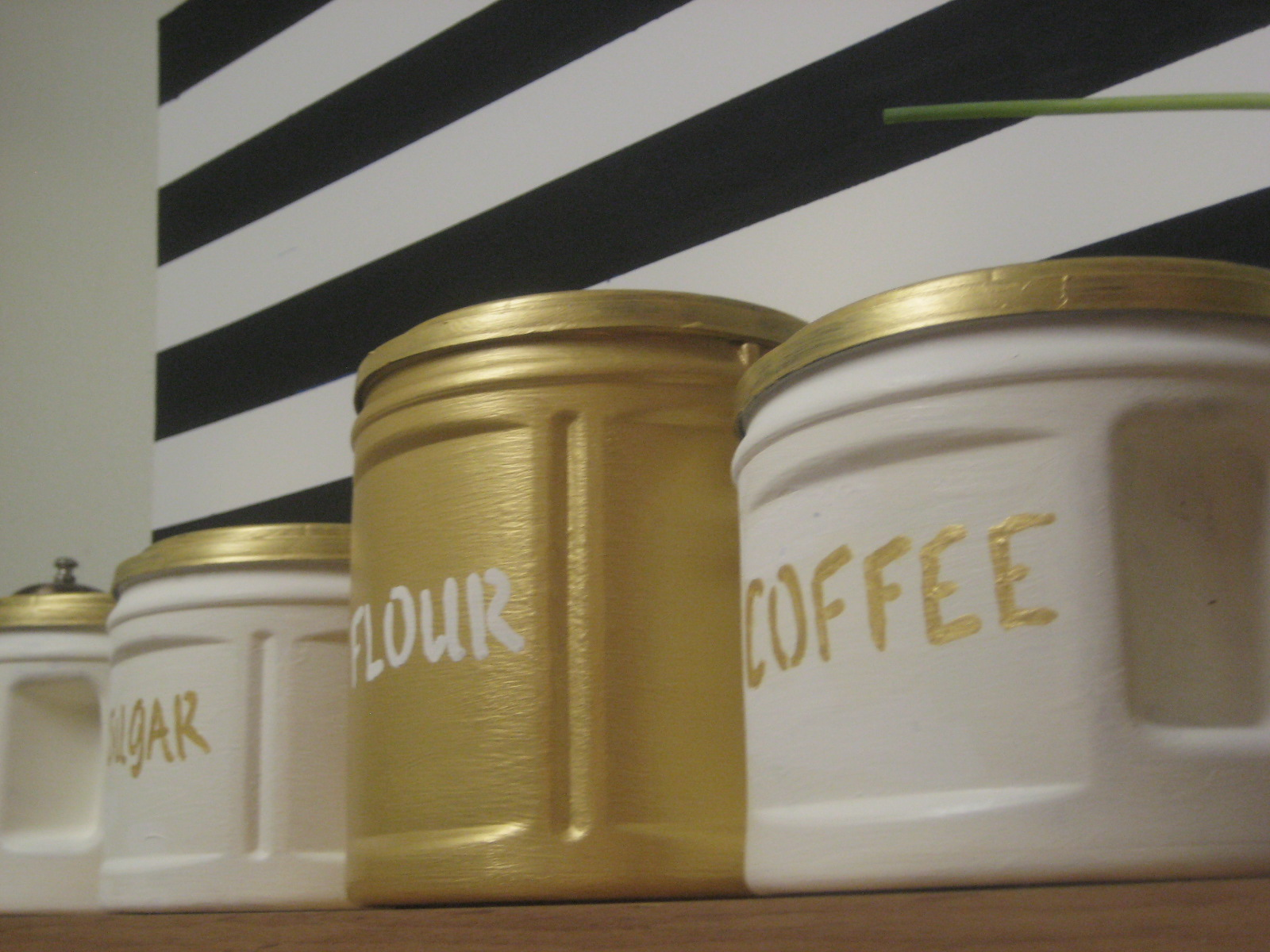 diy gilded canisters made from plastic folgers coffee cans