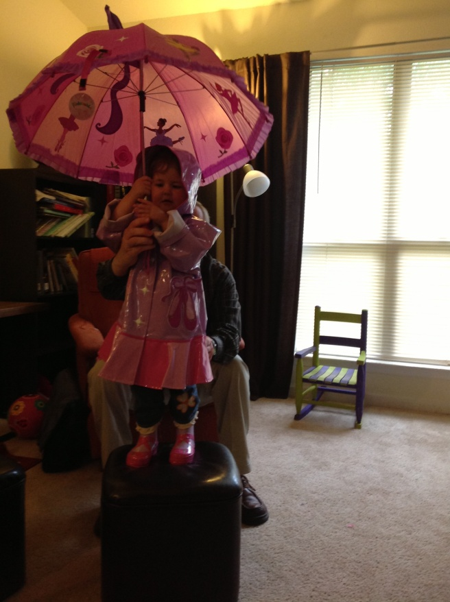 The complete ensemble: raincoat, boots, umbrella.