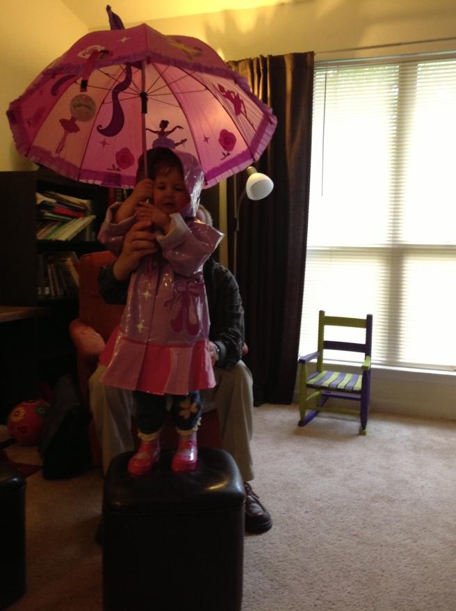 The complete ensemble: raincoat, boots, umbrella.