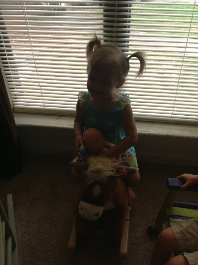 A little dark, but I love that she was giving her baby a ride on the horse.