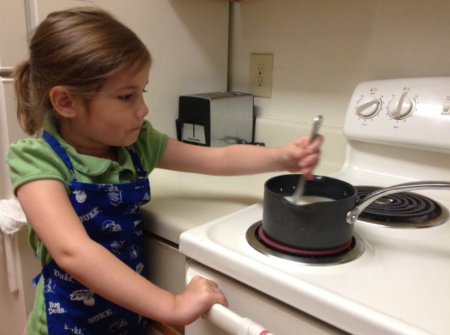 Almost too much for this safety nut to handle. Hopey stirred a pot on the stove for the first time for her bread-making history project.