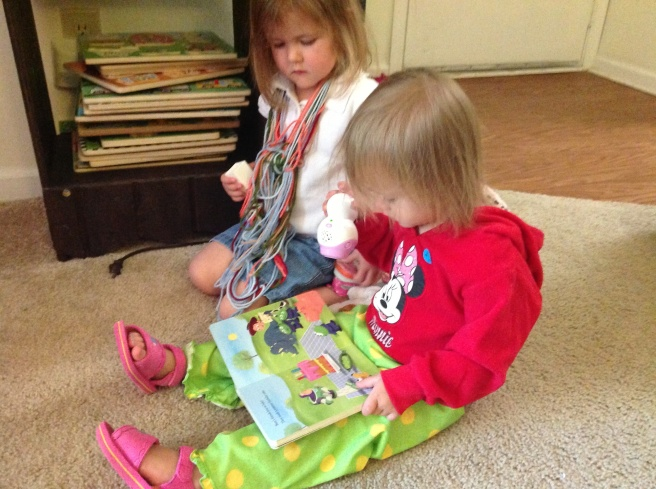 "Gracie and Mckayla love sitting next to each to ""read."" Mckayla is sporting her ""does my mom ever do laundry"" outfit."