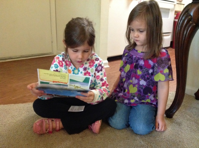 Hope reading her Sparks material to Sophia.