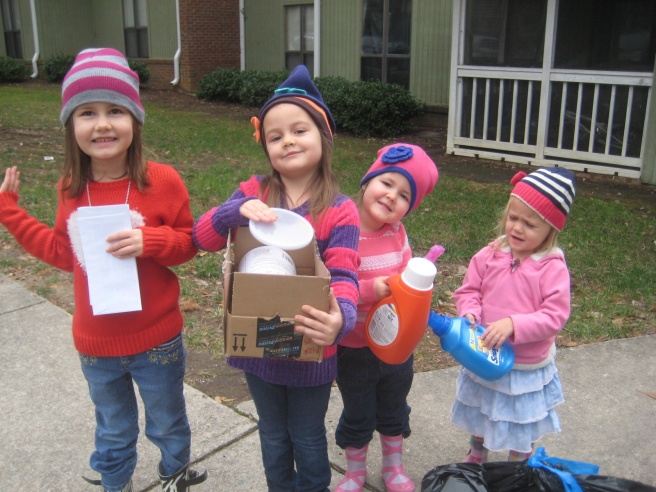 "The girls love to carry things to the dumpster. They always turn them into marching band instruments. As soon as we get out of the stairwell, they begin to march and say, ""Rat-a-tat, BOOM!"""
