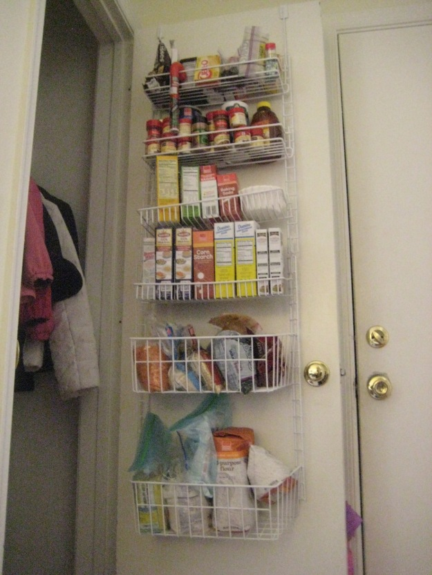Over-the-door hanging organizer for food storage in coat closet