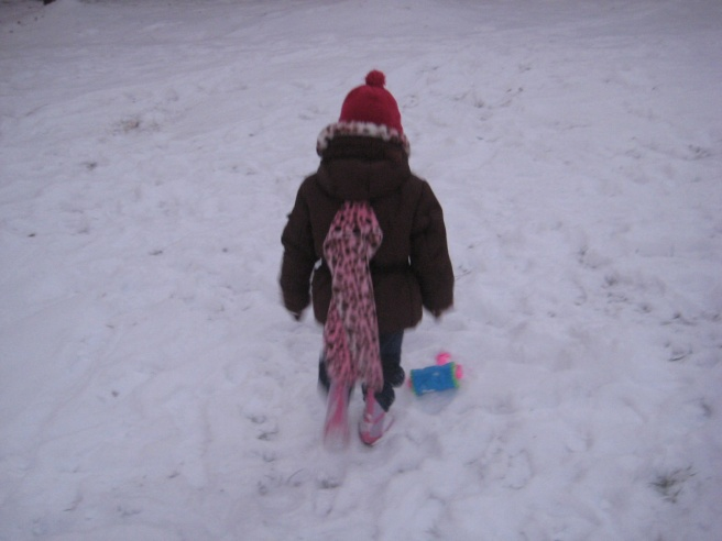 Greatly objecting to the snowman picture. She was cold and ready to go inside!