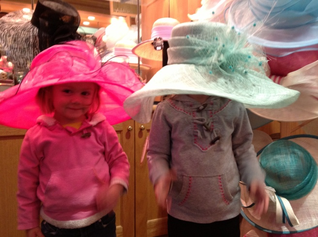 Gracie could not get the hat to stay up and show her face.