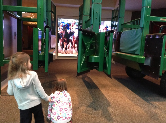 Gates and simulation at the entrance of the Kentucky Derby museum.