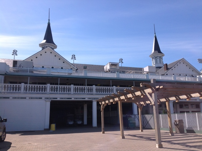 """Backstage."" Walking past the jockey's quarters, seeing the names of the winners along the roof, the stalls where the horses are saddled...amazing."