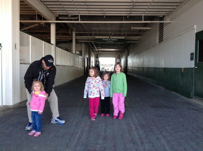 This is the tunnel the horses pass through when entering the track. And our sweet guide was trying to help Mckayla be in the picture, but...