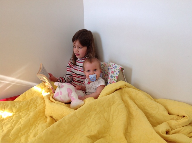 Big sis reads to littlest sis
